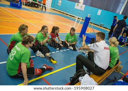 MOSCOW - MAY 11: Players team Hungary (green) and coach at 4 Open Moscow sitting volleyball match between Hungary (green) and Finland (blue), on May 11, 2014, in Moscow stadium CSP Izmailovo, Russia