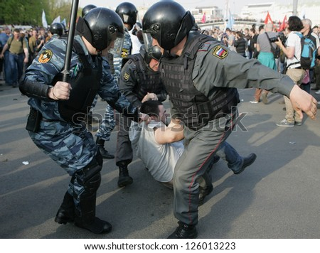 MOSCOW - MAY 6: Police detain participants of the demonstration against newly elected president Vladimir Putin on May 6, 2012 in Moscow, Russia.