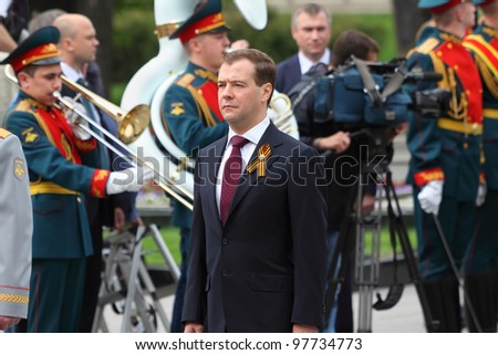 MOSCOW - MAY 8: President Dmitry Medvedev at beautiful ceremony of wreath laying at tomb of Unknown Soldier at Victory Day, on May 8, 2011, Moscow, Russia.