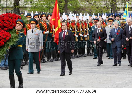MOSCOW - MAY 8: President Dmitry Medvedev, Prime minister Vladimir Putin, deputies and veterans at ceremony of wreath laying at tomb of Unknown Soldier at Victory Day, on May 8, 2011, Moscow, Russia.