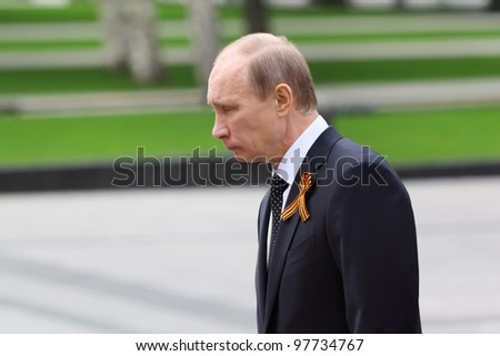 MOSCOW - MAY 8: Prime minister Vladimir Putin at ceremony of wreath laying at tomb of Unknown Soldier at Victory Day, on May 8, 2011, Moscow, Russia.