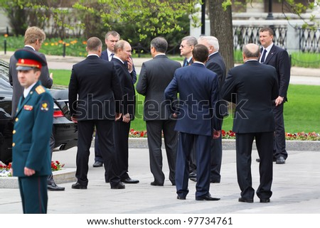 MOSCOW - MAY 8: Prime minister Vladimir Putin, bodyguards and State Duma deputies at ceremony of wreath laying at tomb of Unknown Soldier at Victory Day, on May 8, 2011, Moscow, Russia. - stock photo