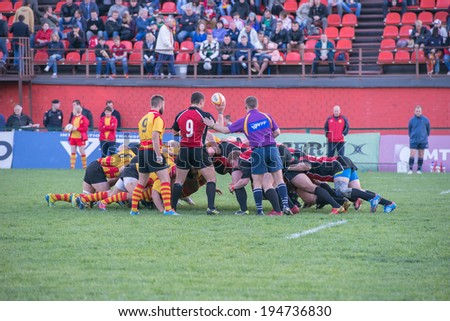 MOSCOW - MAY 13: Some players in a scrum in the Russian Rugby Championship 2014 match between Slava CSP (yellow) and Metallurg (black), on May 13, 2014, in Moscow stadium Slava Russia.