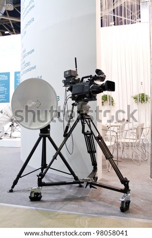MOSCOW-MAY 11: Tv satellite and camera at the international exhibition of the telecommunications industry Sviaz-Expocomm on May 11, 2011 in Moscow