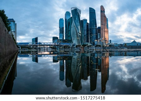 Moscow. Moskva-city. Urban landscape in gray tones. Skyscrapers on the background of gray water. Tall buildings are reflected in the water. Downtown business district. Business centre. #1517275418