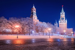 Moscow night. Russia. Red Square in winter. Snow near walls of Kremlin.