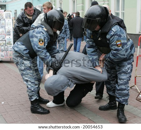 MOSCOW - NOVEMBER 4: Policemen detain a participant of a nationalist rally in downtown Moscow on November 4, 2008, Russia.