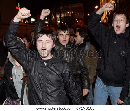 "MOSCOW, NOVEMBER 12: Russian opposition protesters shout ""Down with Putin (acting prime minister)"" as they march along a central street November 12, 2010 in Moscow, Russia,"