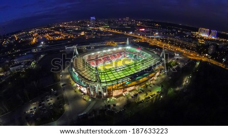 MOSCOW - OCT 21: Night view from unmanned quadrocopter to Lokomotiv Stadium with football field and city lights on horizon on October 21, 2013 in Moscow, Russia.