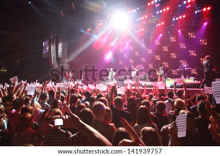 MOSCOW - OCT 12: Spectators hold American flags on DAUGHTRY group performs on stage of Stadium Live on October 12, 2012 in Moscow, Russia. #141939757