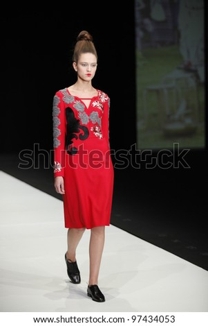 MOSCOW - OCTOBER 24: A models walks runway at the Tatiana Parfionova Collection for Spring/ Summer 2012 during Volvo Fashion Week on October 24, 2011 in Moscow, Russia