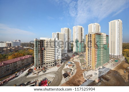 MOSCOW - OCTOBER 7: Buildings under construction of residential complex Elk Island on October 7, 2011 in Moscow, Russia. This is 12-29 storey buildings with living area of 100 000 square meters.