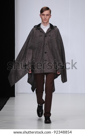 MOSCOW - OCTOBER 21: Male model walking runway at the Leonid Alexeev Collection for Spring/ Summer 2012 during Mercedes-Benz Fashion Week on October 21, 2011 in Moscow, Russia