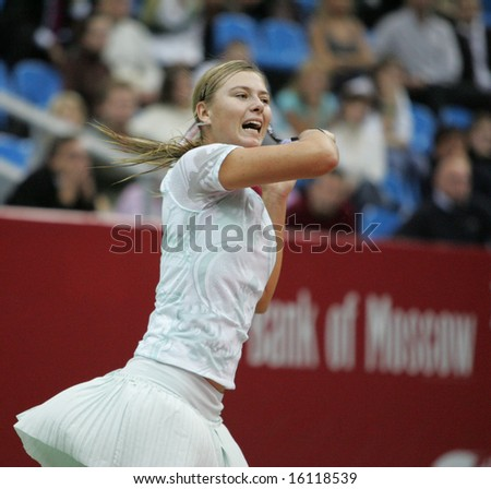 MOSCOW - OCTOBER 11: Maria Sharapova, Russian tennis player, returns the ball at the Moscow's Kremlin Cup October 11, 2006 in Moscow, Russia.