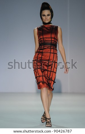 MOSCOW - OCTOBER 31: Model walks runway at the Arsenicum Collection for Spring/ Summer 2012 during Volvo Fashion Week on October 31, 2011 in Moscow, Russia