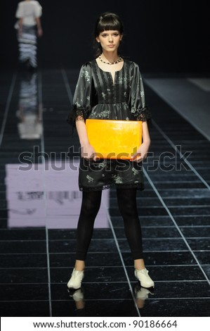 MOSCOW - OCTOBER 30: Model walks runway at the Daria Razumikhina Collection for Spring/ Summer 2012 during Volvo Fashion Week on October 30, 2011 in Moscow, Russia - stock photo