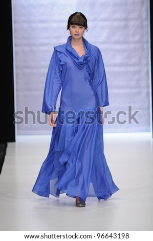 MOSCOW - OCTOBER 23: Model walks runway at the Xakama for S/S 2012 during MBFW on October 23, 2011 in Moscow, Russia