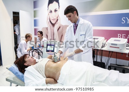 MOSCOW - OCTOBER 26: Procedure of vacuum massage at the international exhibition of professional cosmetics and beauty salon equipment INTERCHARM on October 26, 2011 in Moscow