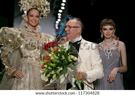 MOSCOW - OCTOBER 18: Russian designer Slava Zaitsev, greets the audience during Fashion Week in Moscow October 18, 2012 in Moscow, Russia.