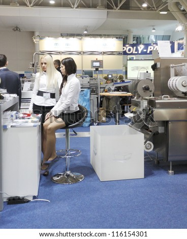 MOSCOW- OCTOBER 12:The machine is a German company MULTIVAC printing labels for sticking to upakovki with food at the international exhibition AGROPRODMASH `2011 on October 12,2011 in Moscow