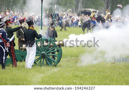 MOSCOW REGION, RUSSIA - MAY 27: Unidentified Soldiers shutting by cannon during 200 unniversary re-enactment of the Borodino battle in 1812. May 27, 2012 in Borodino, Russia