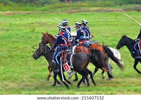 MOSCOW REGION - SEPTEMBER 07, 2014: Reenactors dressed as Napoleonic war soldiers at Borodino battle historical reenactment. #215607532