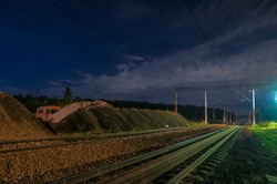 Moscow region, track repair, Railway night landscape, dark background, blue sky, high speed railway, big Moscow circle line, freight trains railroad with new ballast, crushed stone
