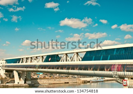 MOSCOW, RUSSIA - APR 08: Commerce and pedestrian bridge \