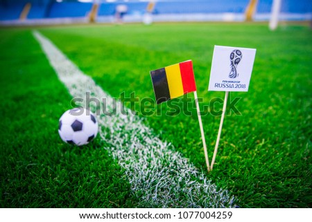 MOSCOW, RUSSIA - APRIL, 24, 2018: Belgium national flag and Official logo of Football FIFA World Cup 2018 in Russia. #1077004259