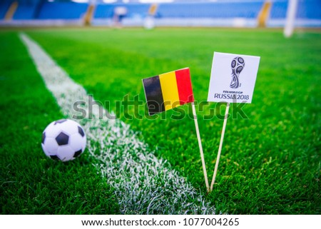MOSCOW, RUSSIA - APRIL, 24, 2018: Belgium national flag and Official logo of Football FIFA World Cup 2018 in Russia. #1077004265