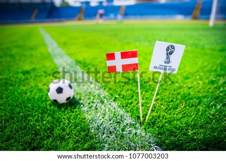 MOSCOW, RUSSIA - APRIL, 24, 2018: Denmark national flag and Official logo of Football FIFA World Cup 2018 in Russia. #1077003203