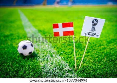 MOSCOW, RUSSIA - APRIL, 24, 2018: Denmark national flag and Official logo of Football FIFA World Cup 2018 in Russia. #1077044996