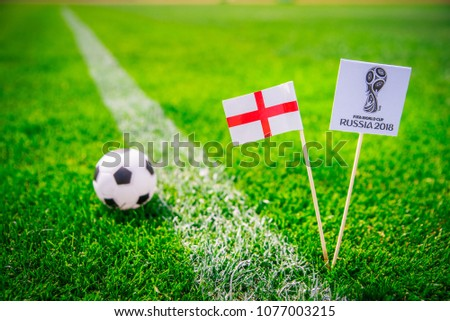 MOSCOW, RUSSIA - APRIL, 24, 2018: england national flag and Official logo of Football FIFA World Cup 2018 in Russia. Green grass, edit space in background. #1077003215