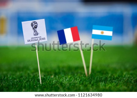 MOSCOW, RUSSIA - APRIL, 24, 2018: France - Argentina, 16-final, eight final, 30. June, Football FIFA World Cup, Russia 2018, National Flags on green grass, white football ball on ground. #1121634980