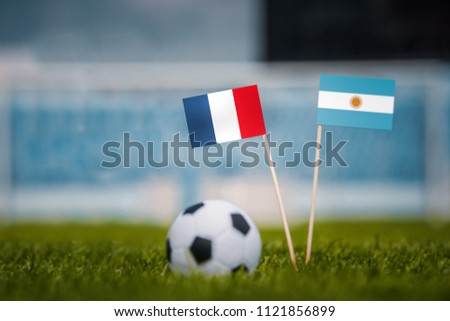 MOSCOW, RUSSIA - APRIL, 24, 2018: France - Argentina, 16-final, eight final, 30. June, Football FIFA World Cup, Russia 2018, National Flags on green grass, white football ball on ground. Play-off #1121856899