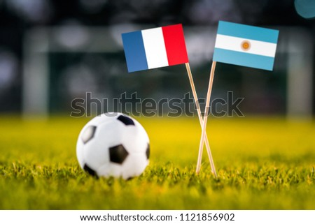 MOSCOW, RUSSIA - APRIL, 24, 2018: France - Argentina, 16-final, eight final, 30. June, Football FIFA World Cup, Russia 2018, National Flags on green grass, white football ball on ground. Play-off #1121856902