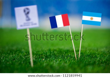 MOSCOW, RUSSIA - APRIL, 24, 2018: France - Argentina, 16-final, eight final, 30. June, Football FIFA World Cup, Russia 2018, National Flags on green grass, white football ball on ground. Play-off #1121859941