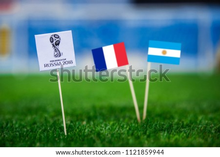 MOSCOW, RUSSIA - APRIL, 24, 2018: France - Argentina, 16-final, eight final, 30. June, Football FIFA World Cup, Russia 2018, National Flags on green grass, white football ball on ground. Play-off #1121859944