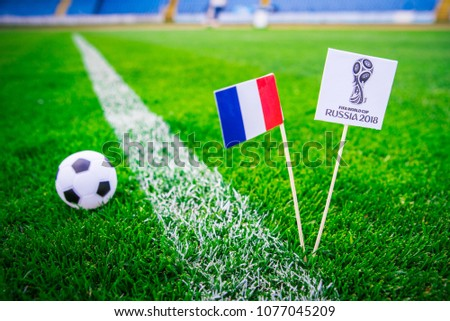 MOSCOW, RUSSIA - APRIL, 24, 2018: France national flag and Official logo of Football FIFA World Cup 2018 in Russia. Green grass, edit space in background. #1077045209