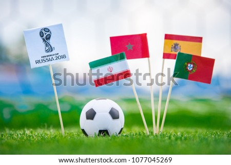 MOSCOW, RUSSIA - APRIL, 24, 2018: Group B - National flags of Portugal, Spain, Morocco, IR Iran and Official logo of FIFA World Cup 2018 in Russia. and Russian national flag. White background, #1077045269