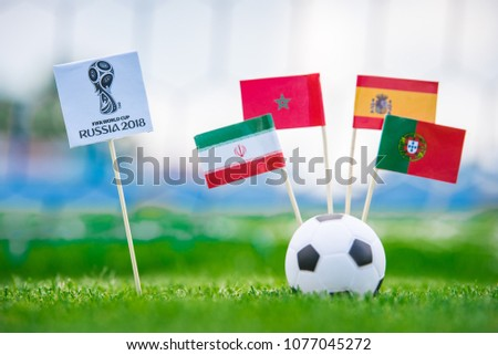 MOSCOW, RUSSIA - APRIL, 24, 2018: Group B - National flags of Portugal, Spain, Morocco, IR Iran and Official logo of FIFA World Cup 2018 in Russia. and Russian national flag. White background, #1077045272