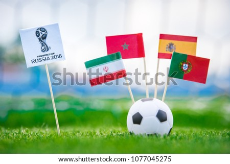 MOSCOW, RUSSIA - APRIL, 24, 2018: Group B - National flags of Portugal, Spain, Morocco, IR Iran and Official logo of FIFA World Cup 2018 in Russia. and Russian national flag. White background, #1077045275