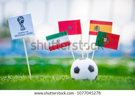 MOSCOW, RUSSIA - APRIL, 24, 2018: Group B - National flags of Portugal, Spain, Morocco, IR Iran and Official logo of FIFA World Cup 2018 in Russia. and Russian national flag. White background, #1077045278