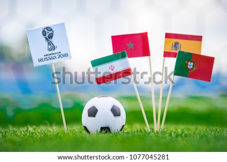 MOSCOW, RUSSIA - APRIL, 24, 2018: Group B - National flags of Portugal, Spain, Morocco, IR Iran and Official logo of FIFA World Cup 2018 in Russia. and Russian national flag. White background, #1077045281