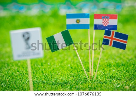 MOSCOW, RUSSIA - APRIL, 24, 2018: Group D - National flags of Argentina, Iceland, Croatia, Nigeria and Official logo of FIFA World Cup 2018 in Russia. White background, edit space. #1076876135
