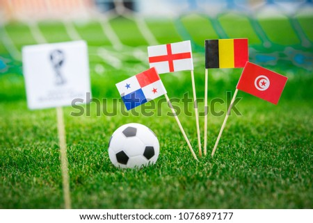 MOSCOW, RUSSIA - APRIL, 24, 2018: Group G - National flags of Belgium, Panama, Tunisia, England and Official logo of FIFA World Cup 2018 in Russia. White background, edit space. #1076897177