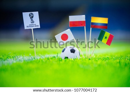 MOSCOW, RUSSIA - APRIL, 24, 2018: Group H - National flags of Poland, Senegal, Columbia, Japan and Official logo of FIFA World Cup 2018 in Russia. White background, edit space. #1077004172