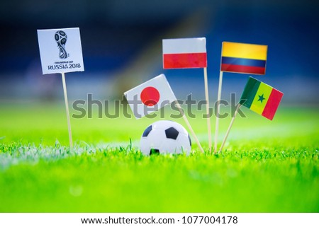 MOSCOW, RUSSIA - APRIL, 24, 2018: Group H - National flags of Poland, Senegal, Columbia, Japan and Official logo of FIFA World Cup 2018 in Russia. White background, edit space. #1077004178
