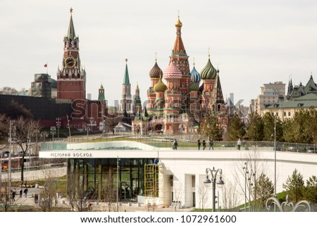 MOSCOW, RUSSIA - APRIL 19,  2018: Landscape Park Zaryadye in Moscow, Russia. View of St. Basil's Cathedral and Spasskaya Tower of the Moscow Kremlin in Spring Day. Natural Light Selective Focus