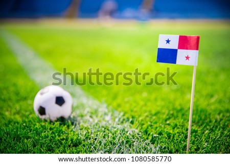 MOSCOW, RUSSIA - APRIL, 24, 2018: Panama national Flag and football ball on green grass. Fans, support photo, edit space #1080585770